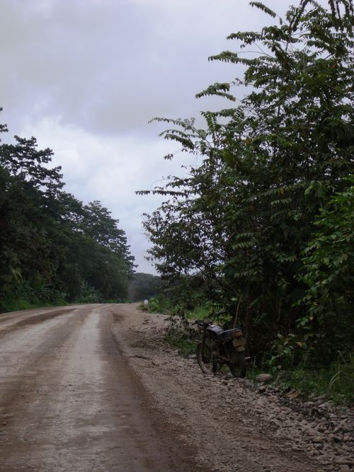 Road to Playa Dominical - muddy motorcycle